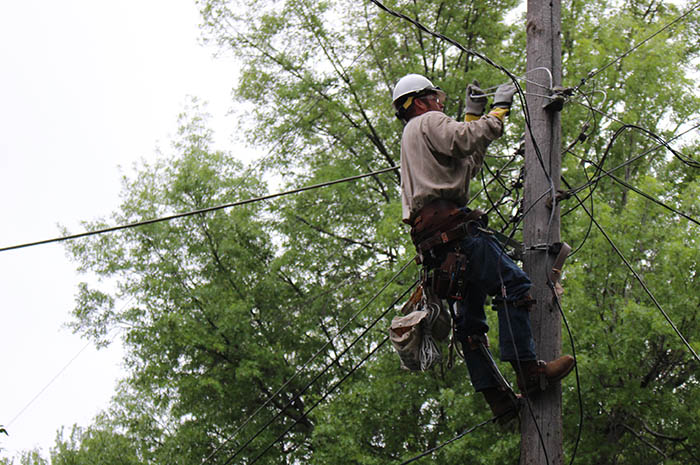 Dave Tonjes repairs a line high on a power pole during a troubleshooter call.