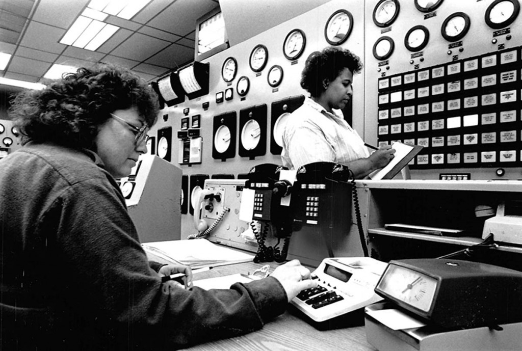 Betty Queen, left, at work in the the control room of Fort Calhoun Station. OPPD archive photo