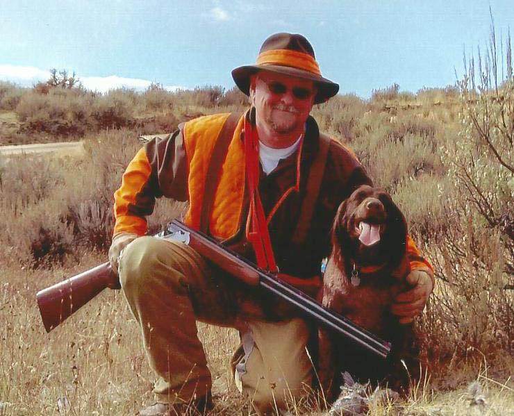 Chris Vrtiska with his hunting dog, Yasha, during a trip to Idaho.
