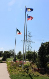 arboretum in summer, flags on their poles at the OPPD Arboretum