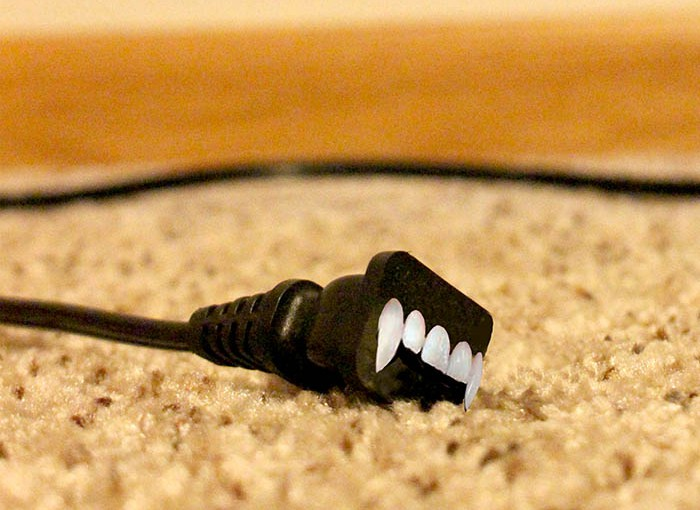 vampire energy, an electrical plug with vampire teeth