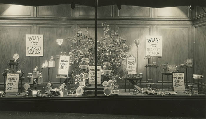 The latest electric appliances shine in a display window at OPPD's downtown headquarters. At the time, the utility displayed items for area dealers. OPPD archive photo