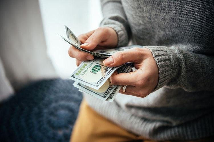 55417059 – hands counting us dollar bills