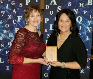 COM_Patty Coates_with award