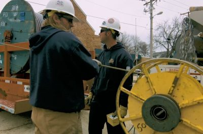 outage restoration process for OPPD involving underground cable wires on a spool