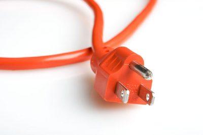 11945765 – close up of an orange power plug