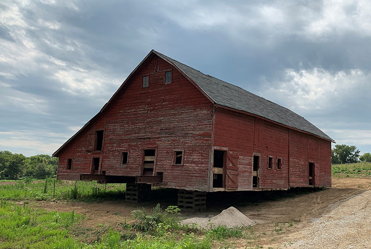 Sarpy County barn move The barn rests near its new permanent home at Vala's.. Photo courtesy of Tim Vala