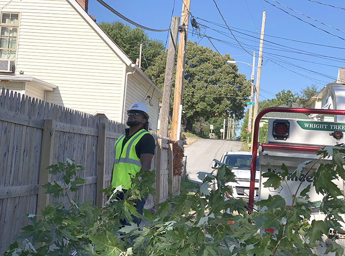 A utility forester inspects a job site in Omaha