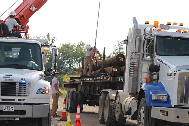 T&D_Apprentice Wrap Job_unload poles 2