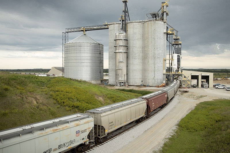 A train carrying grain moves through the Frontier Co-Op facility in Syracuse, Neb., rail partnership