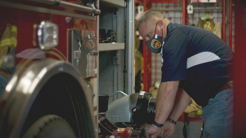 An OPPD employee checks his volunteer firefighter equipment at the fire station. November, 2020 employee firefighters