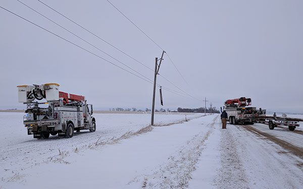 galloping power lines, bucket trucks on the side of the road in winter