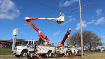 Line crews work on power lines.